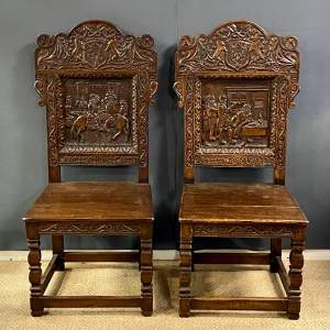 Pair of 19th Century Heavily Carved Oak Hall Chairs
