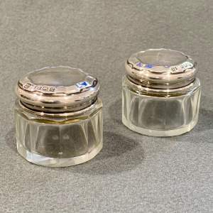 Early 20th Century Pair of Matching Silver Topped Glass Pots