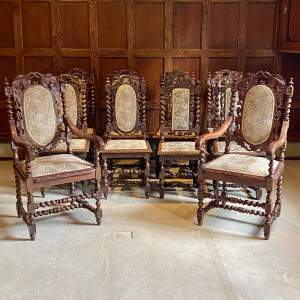 Harlequin Set of Ten Highly Carved Oak Dining Chairs