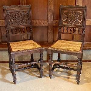Pair of Late Victorian Carved Oak Hall Chairs