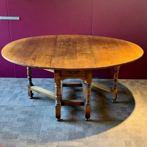 Large Oval Oak Drop Leaf Dining Table image-1