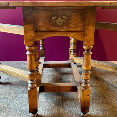 Large Oval Oak Drop Leaf Dining Table image-4