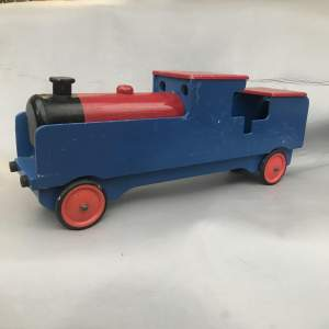 A Large Wooden Hand Made Painted Toy Train