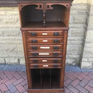 A Tall Art Nouveau Mahogany Cabinet