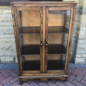 A 20th Century Oak Glazed Cabinet With Three Shelves