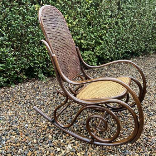 Stylish early 20th Century Fischel Bentwood Rocking Chair image-1