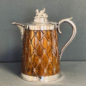 Edwardian Silver Plated and Oak Cased Jug