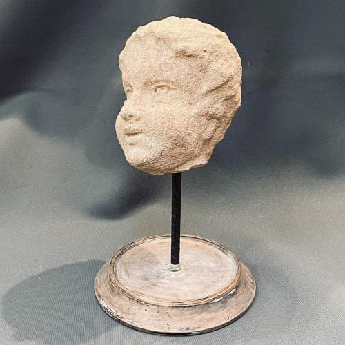 A 17th Century Carved Fossil Limestone Sculpture of a Cherub image-1