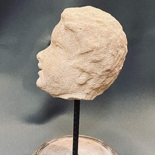 A 17th Century Carved Fossil Limestone Sculpture of a Cherub image-4