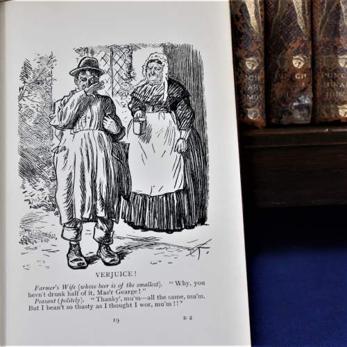 Punch Library of Humour - 24 Editions on Oak Book Rack image-6