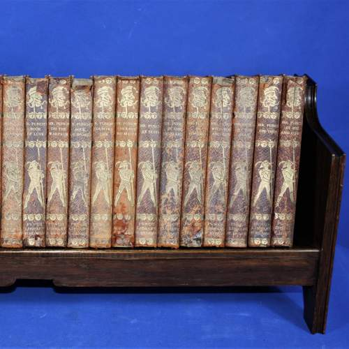 Punch Library of Humour - 24 Editions on Oak Book Rack image-3