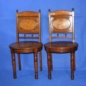 A Fine Pair of Arts and Crafts Oak Hall Chairs