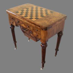 A Victorian Burr Walnut Boxwood and Ebony Games and Work Table