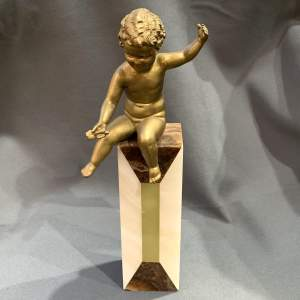 1920s Spelter Figure of a Putti sat on a Marble Column