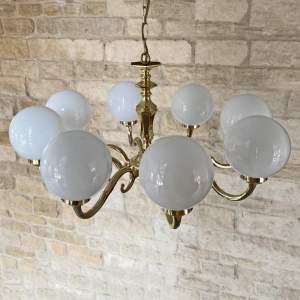 Brass Chandelier with Glass Globe Shades