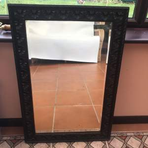 A Rectangular Carved Wall Mirror With Bevelled Glass