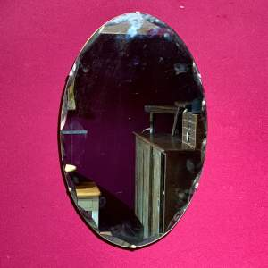Frameless Bevelled Oval Wall Mirror