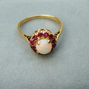 A 9ct Yellow Gold Opal and Ruby Ring