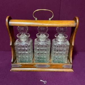 Early 20th Century Mahogany Tantalus Containing Three Decanters