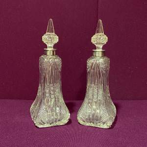 Pair of Silver Collared Cut Glass Scent Bottles