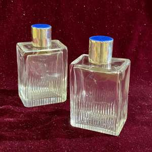 Pair of Early 20th Century Aspreys Bottles with Enamel Tops