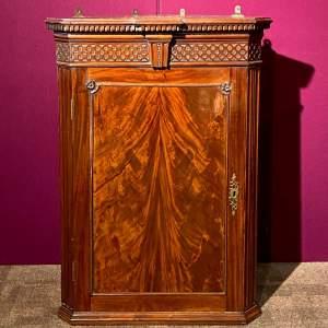19th Century Flame Mahogany Corner Cabinet