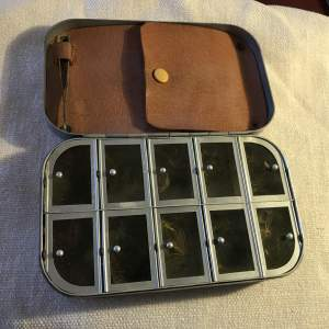 A Wheatley Silmalloy Fly Tin with 10 compartments holding flies