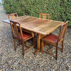 Oak Draw Leaf Dining Table with Four Matching Chairs