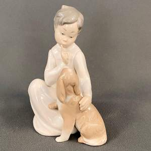 Lladro Boy with Dog Figurine