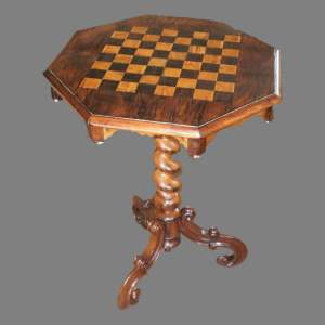 A Victorian Rosewood Table with Inlaid Chequer Board Top