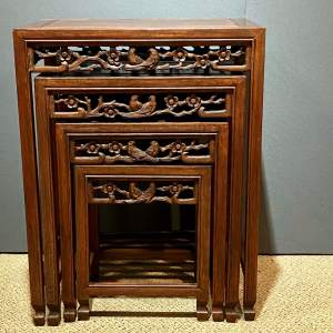 Set of Four Graduated Carved Oriental Side Tables