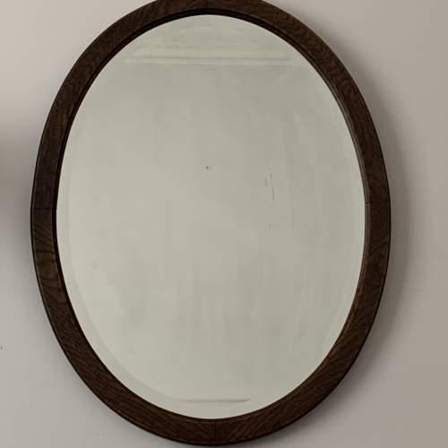 Oak Framed Bevelled Edge Oval Mirror image-1