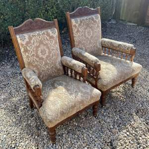 A Pair of Late Victorian His and Hers Salon Armchairs