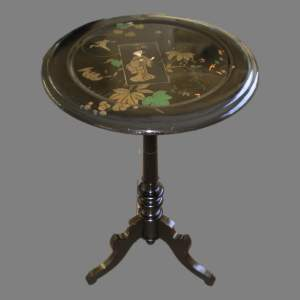 An Ebonised Occasional Chinoiserie Tilt Top Table