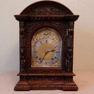 Carved Oak Cased Clock by Winterhalder and Hoffmeir