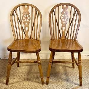 Mid 20th Century Pair of Golden Wheelback Windsor Chairs