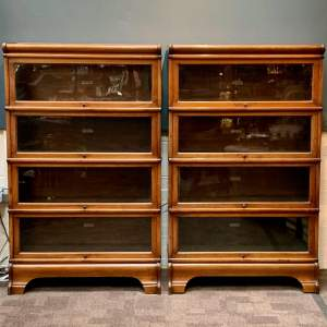 20th Century Pair of Mahogany Four Tier Globe Wernicke Bookcases