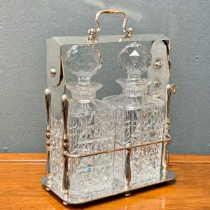 Edwardian Two Bottle Tantalus On Silver Plate Stand
