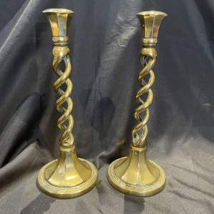 An Elegant  Pair Of  Brass Candlesticks With Twisted Stem