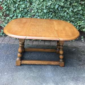 Solid Golden Oak Twist Top Drop Leaf Table