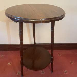 A  Small Circular Wine Table With Turned Legs