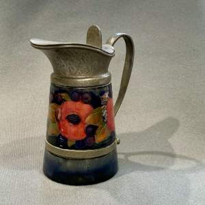 Liberty and Co Moorcroft and Liberty Tudric Pewter Jug