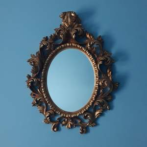 A Beautifully Carved and Gilded Wooden Framed Wall Mirror