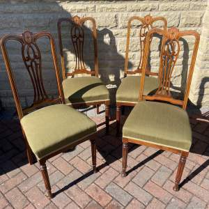 A Set of Four Edwardian Inlaid Dining Chairs