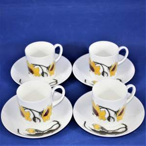 Wedgwood Four Susie Cooper Black Eyed Susan Coffee Cans and Saucers
