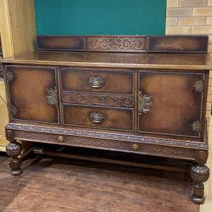 Carved Oak and Studded Leather Sideboard