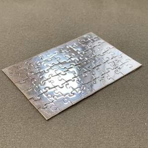 Silver 54 Piece Jigsaw Puzzle by Brenton West
