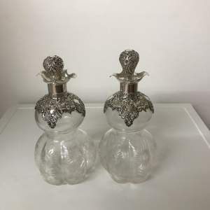 A Pair of Cut Glass and Silver-Topped Decanters - Birmingham 1899