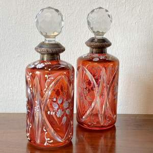 Pair of Silver Rimmed Cut Glass Decanters