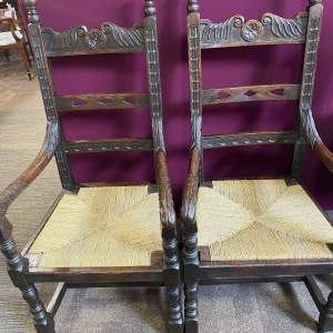 A Pair of 19th Century Oak Arm Chairs with Rush Seats
